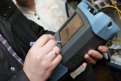 Engineer measuring fiber optic