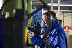 Engineer measuring noise levels. In a factory / plant royalty free stock photography