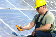 Engineer is measuring solar insolation on the solar panel Royalty Free Stock Images