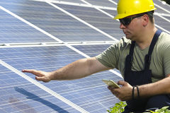 Engineer is measuring solar insolation on the solar panel Stock Images