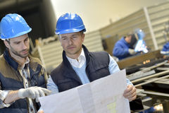 Engineer with mechanical worker in a metallurgic factory Royalty Free Stock Image
