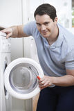 Engineer Mending Domestic Washing Machine. Male Engineer Mending Domestic Washing Machine Royalty Free Stock Photos