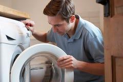 Engineer Mending Domestic Washing Machine Stock Photography