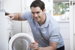 Engineer Mending Domestic Washing Machine Stock Photography