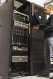 IT Engineer Monitoring Servers. IT Engineer/ Consultant monitoring systems and servers in a datacenter stock photography