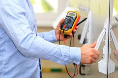 Engineer with multimeter closeup stock photography