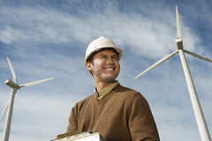 Engineer Near Turbines At Wind Farm Stock Photography