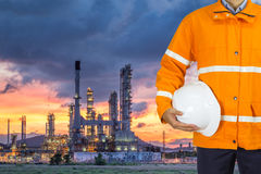 Engineer oil industry wearing safety coat and holding helmet Royalty Free Stock Photos