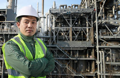 Engineer oil refinery. Engineer standing in front of a large oil refinery Stock Photography