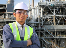 Engineer oil refinery. Engineer and large oil refinery background Stock Image