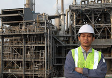 Engineer oil refinery. Standing on location site Royalty Free Stock Image