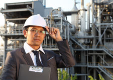 Engineer oil refinery. Holding a notepad Royalty Free Stock Image