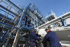 Engineer and oil refinery Stock Photos