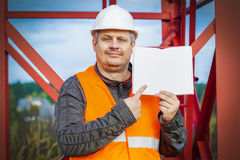 Engineer with open empty book at outdoor Royalty Free Stock Image