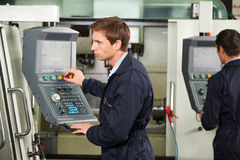 Engineer Operating Computer Controlled Cutting Machine Royalty Free Stock Photos