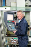 Engineer Operating Computer Controlled Cutting Machine Stock Images