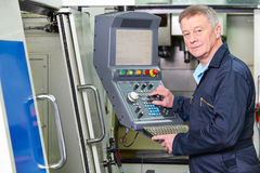 Engineer Operating Computer Controlled Cutting Machine Stock Photography