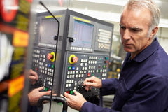 Engineer Operating Computer Controlled Lathe Stock Photo