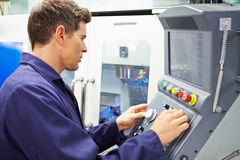 Engineer Operating Computer Controlled Milling Machine. Skilled Engineer Operating Computer Controlled Milling Machine In Factory Stock Image