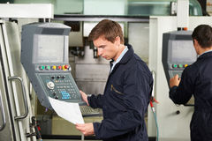 Engineer Operating Computerized Cutting Machine Royalty Free Stock Photography