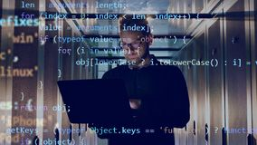IT engineer is operating a laptop with encrypted code going above him