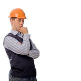 Engineer in orange helmet thinking Royalty Free Stock Image