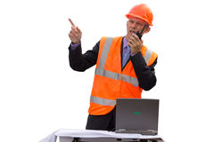Engineer in orange jacket and helmet talk by radi Stock Photo