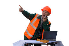 Engineer in orange jacket and helmet talk by radi Stock Images