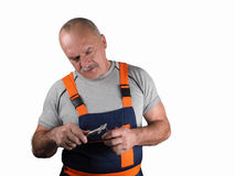 Engineer in overalls holds change royalty free stock photography
