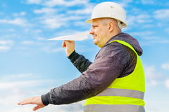 Engineer with paper airplane Royalty Free Stock Image