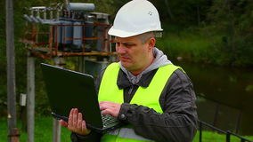 Engineer with PC at outdoor stock footage