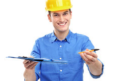 Engineer with pen and clipboard Royalty Free Stock Photography