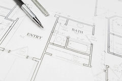 Engineer Pencil and Ruler Resting on House Plans Stock Image