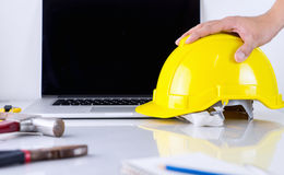 Engineer is picking up safety helmet Royalty Free Stock Photography