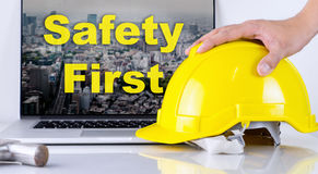 Engineer is picking up safety helmet for Safety First. Concept Stock Photography