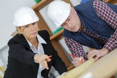 Engineer planning architectural project with engineering tools stock photos