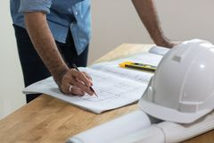 Engineer planning on blue print on working table stock photography