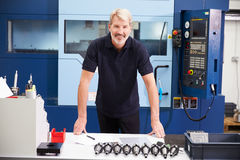 Engineer Planning Project With CNC Machinery In Background Royalty Free Stock Photos