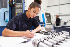 Engineer Planning Project With CNC Machinery In Background Stock Image