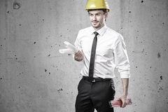 Engineer with plans and spirit level Royalty Free Stock Photo