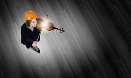 Engineer play violin Stock Images