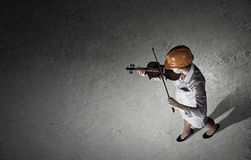 Engineer play violin Stock Image