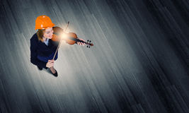 Engineer play violin Royalty Free Stock Image