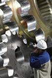 Engineer pointing at gears machinery stock photos