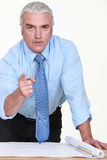 Engineer pointing his finger. Senior engineer pointing his finger Stock Photos