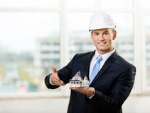 Engineer pointing at model house Royalty Free Stock Image