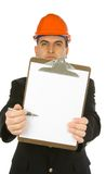 Engineer pointing with pen. Engineer pointing with a pen on a blank paper attached to clipboard stock photo