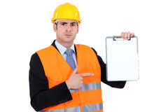 Engineer pointing to a clipboard Stock Images