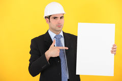Engineer pointing to a sign Stock Image