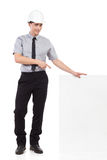 Engineer pointing at white banner. Royalty Free Stock Photo